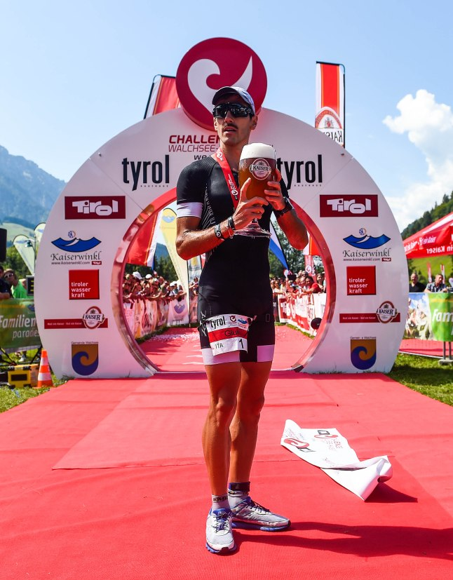 WALCHSEE, AUSTRIA - AUGUST 23:  Giulio Molinari of Italy wins the Challenge Triathlon Walchsee-Kaiserwinkl on August 23, 2015 in Walchsee, Austria.  (Photo by David Ramos/Getty Images for Challenge Triathlons)