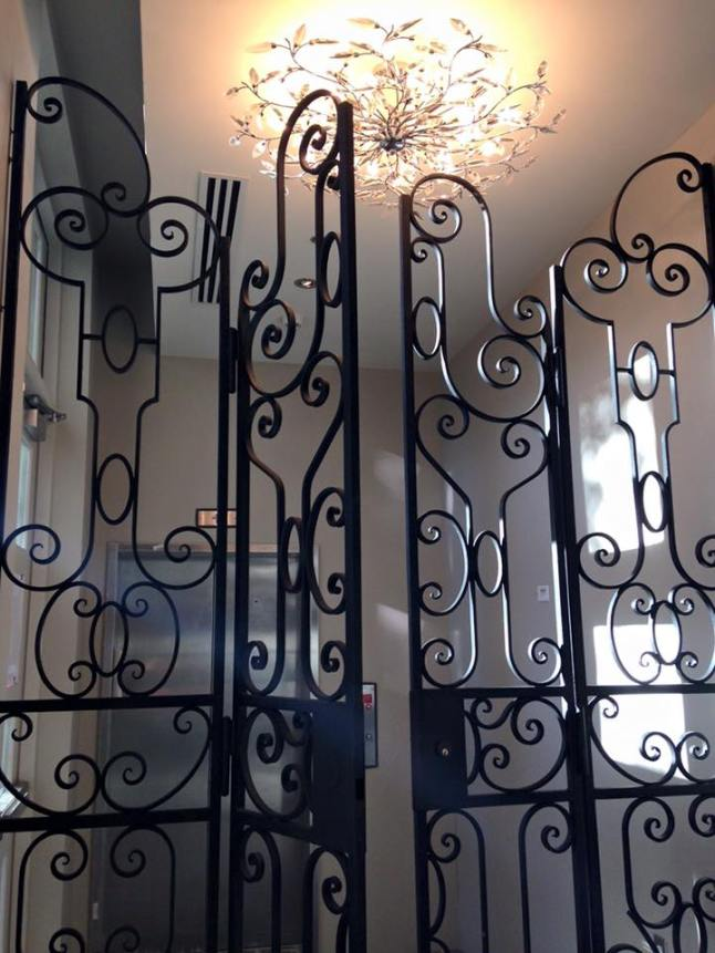 Custom iron gates leading from the Wine Room to the rooftop elevators at Grand Bohemian Hotel Charleston.