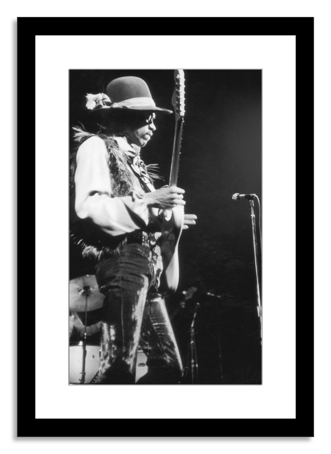 Jimi Hendricks (in concert) by Fred W. McDarrah (Image courtesy of Photo.com by Getty Images)
