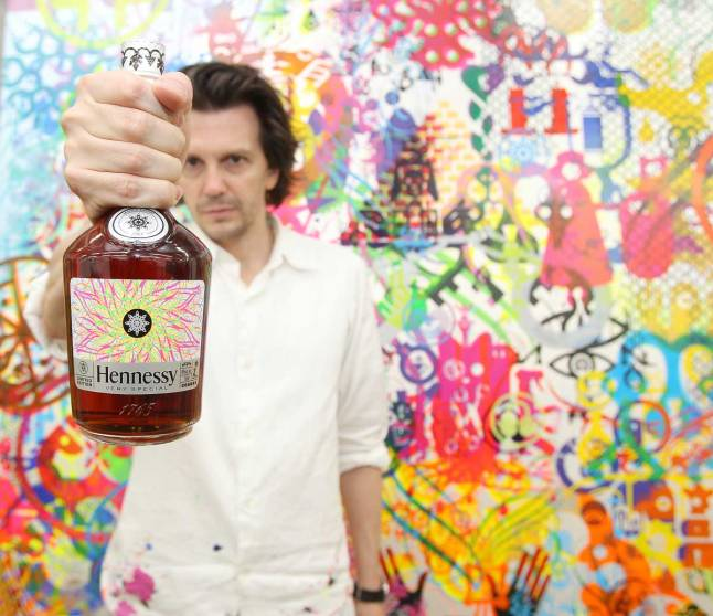 Ryan McGinness holds the Hennessy V.S Limited Edition bottle in his Chinatown Studio