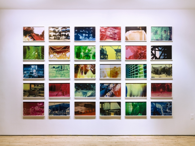 Basim Magdy (Egyptian, born 1977). The Hollow Desire to Populate Imaginary Cities. 2014. Installation view Art in General, New York. 30 chromogenic color prints from chemically altered slides on metallic paper, each 13 3/8 × 20 1/16″ (34 × 51 cm). Photo: Charles Benton. Commissioned by Art in General, New York and HOME, Manchester, U.K. ©2015 Basim Magdy