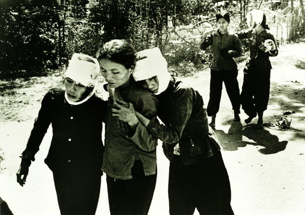Civilian Casualties, 1968. Injured civilians flee their homes in Da Nang on the first day of the Tet Offensive. Photo by Specialist 5 Richard A. 'Dick' Durrance, U.S. Army.