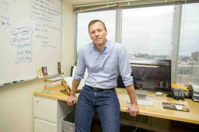 Matthew Desmond sits on his desk in his office in Cambridge, Mass. on Thursday, Sept. 10, 2015. Desmond has been named a 2015 MacArthur Foundation Fellow in recognition of his work in Sociology.