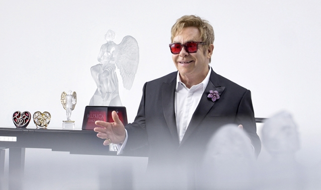 Sir Elton John announcingthe ELTON JOHN MUSIC IS LOVE FOR LALIQUE, a collection of seven exceptional crystal sculptures, four of which will be auctioned off and sold to raise critical funds to fight the global HIV/AIDS epidemic (Phot o Credit: Gilles Pernet)