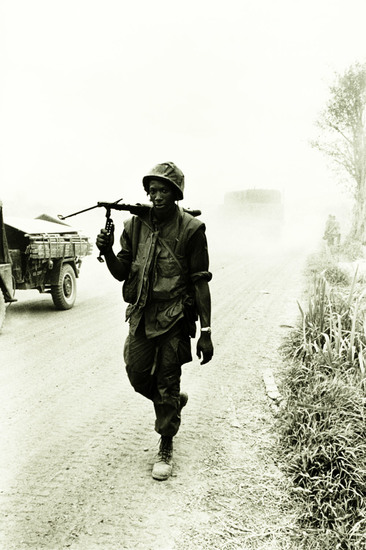 "I'm Walkin' 1968. An infantryman with the U.S. Army 1st Air Cavalry Division carries an M-60 machine gun on a road approaching LZ Stud in Quảng Trị Province, in north Central Vietnam. Photo by Specialist 5 Richard A. ""Dick"" Durrance, U.S. Army."