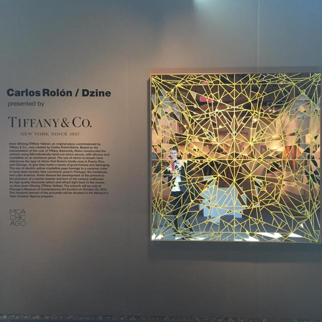Carlos Rolón/Dzine's ' Inner Shining (Tiffany Yellow),' on  exhibit at the newly renovated Tiffany & Co. Michigan Ave store, will be sold with one hundred percent of the proceeds donated to the Chicago Museum of Contemporary Art's Teen Creative Agency program (Photo Credit:  www.facebook.com/expochicago)