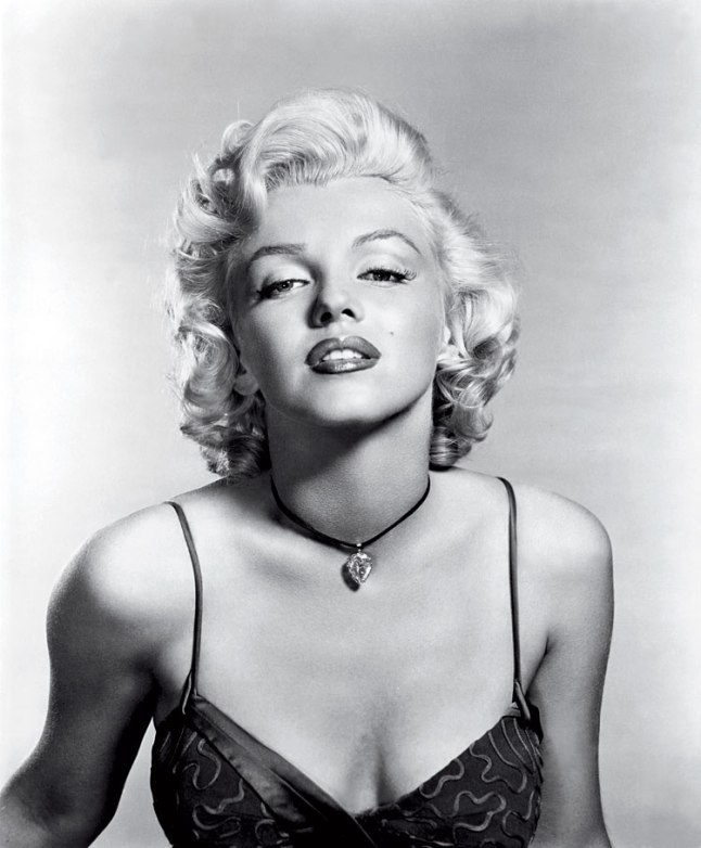 Marilyn Monroe is pictured wearing the Moon of Baroda, a 24-carat, pear shaped yellow diamond. (Photo courtesy of httpwww.jointventurejewelry.com)