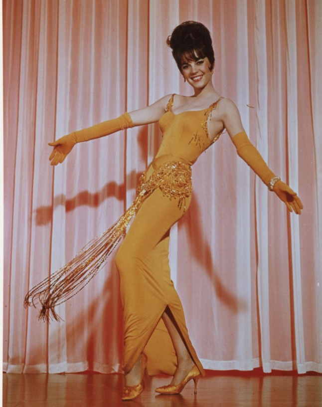 Natalie Wood starred in the classic GYPSY in a costume designed by ORRY-KELLY in a scene from the film WOMEN HE'S UNDRESSED - A FILM BY GILLIAN ARMSTRONG