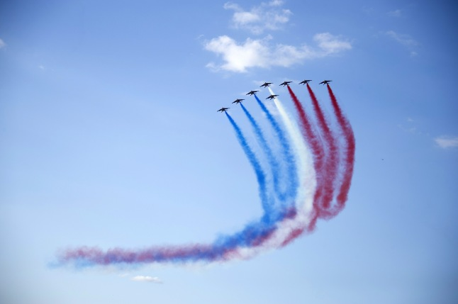VERSAILLES, FRANCE - MAY 20: A general view of the aerial display and fly past by the Patrouille de France in the gardens of the historic Chateau de Versailles on May 20, 2015 in Versailles, France. (Photo by Kristy Sparow/Getty Images for Martell Cognac)