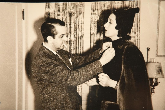 The creative ORRY-KELLY adjusts his costume for his muse Kay Francis in a scene from WOMEN HE'S UNDRESSED - A FILM BY GILLIAN ARMSTRONG