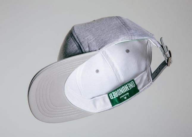 Heineken and RSVP Gallery debut exclusive lambskin and jersey knit cap for #Heineken100 program. (PRNewsFoto/HEINEKEN USA Inc.)