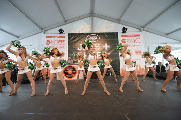 NEW YORK, NY - OCTOBER 18:  New York Jets cheerleaders perform onstage at Jets & Chefs: The Ultimate Tailgate hosted by Joe Namath and Mario Batali during the New York City Wine & Food Festival at Esurance Rooftop Pier 92 on October 18, 2014 in New York City.  (Photo by Gustavo Caballero/Getty Images for NYCWFF)