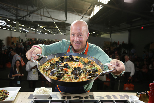 NEW YORK, NY - OCTOBER 18:  TV Personality Andrew Zimmern runs a presentation at KitchenAid stage at the Grand Tasting presented by ShopRite featuring KitchenAid® culinary demonstrations presented by MasterCard during the New York City Wine & Food Festival at Pier 94 on October 18, 2014 in New York City.  (Photo by Neilson Barnard/Getty Images for NYCWFF) *** Local Caption *** Andrew Zimmern
