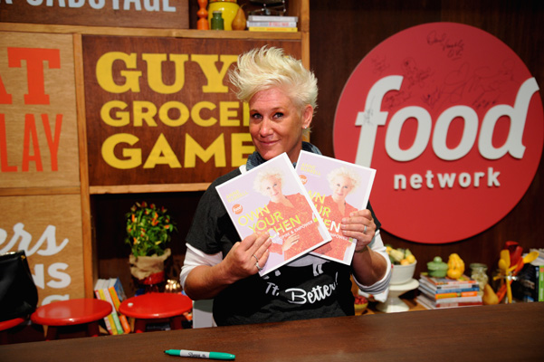 "NEW YORK, NY - OCTOBER 19:  Chef Anne Burrell poses with her book ""Own Your Own Kitchen"" conducts a culinary presentation on KitchenAid stage at the Grand Tasting presented by ShopRite featuring KitchenAid® culinary demonstrations presented by MasterCard during the New York City Wine & Food Festival at Pier 94 on October 19, 2014 in New York City.  (Photo by Bryan Bedder/Getty Images for NYCWFF) *** Local Caption *** Anne Burrell"
