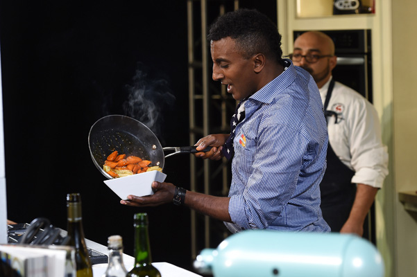 NEW YORK, NY - OCTOBER 19:  Chef Marcus Samuelsson gives a cooking demonstration at the Grand Tasting presented by ShopRite featuring KitchenAid® culinary demonstrations presented by MasterCard during the New York City Wine & Food Festival at Pier 94 on October 19, 2014 in New York City.  (Photo by Larry Busacca/Getty Images for NYCWFF) *** Local Caption *** Marcus Samuelsson