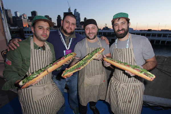 NEW YORK, NY - OCTOBER 19:  Chefs prepare food at Meatopia X: The Carnivore's Ball Presented By Creekstone Farms Hosted By Michael Symon during New York City Wine & Food Festival at Esurance Rooftop Pier 92 on October 19, 2014 in New York City.  (Photo by John Parra/Getty Images for NYCWFF)