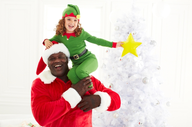 "Shaq-A-Claus is back to partner with Toys""R""Us and the Marine Toys for Tots Foundation for another year to help spread holiday joy to some of the 15.5 million U.S. children living in poverty and is encouraging customers to #PlayItForward."