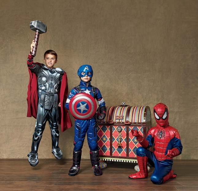 Each personalized MacKenzie-Childs trunk features the child's hand-painted initials and holds a selection of Chasing Fireflies Ultimate Collection costumes. The blue version includes five ©Marvel Super Heroes costumes: Ultimate Light-Up Spider-Man, Ultimate Thor, Star-Lord coat & mask set, Ultimate Captain America®, and Ultimate Light-Up Hulk Buster.