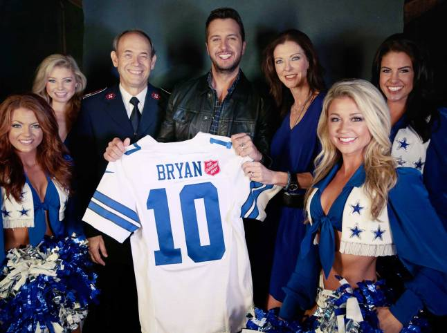 Luke Bryan was joined by Charlotte Jones Anderson, Lt. Col. Ron Busroe and the Dallas Cowboys cheerleaders before his concert in Dallas to announce that he will kickoff The Salvation Army Red Kettle Campaign with a halftime performance during the Dallas Cowboys Thanksgiving Day game.