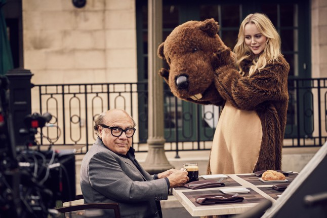 """Danny DeVito, with supporting actor, Helena Mattsson, on the set of the new Nespresso """"Experience a cup above"""" advertising shoot in Los Angeles, CA"""