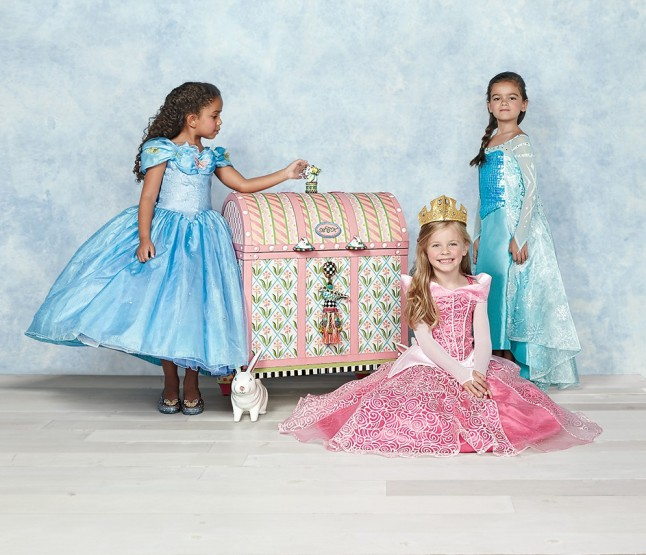 Each personalized MacKenzie-Childs trunk features the child's hand-painted initials and holds a selection of Chasing Fireflies Ultimate Collection costumes. The pink version, an equally delightful trunk holds Disney favorites Ultimate Collection Elsa, Ultimate Collection Aurora, Ultimate Collection Sophia the First, and Ultimate Cinderella Ball Gown.