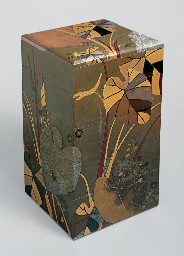 Shibata Zeshin, Japanese, 1807–1891, Jūbako with Taro Plants and Chrysanthemums Japan, late Edo (1615–1868)–Meiji (1868–1912) period, 19th century. Colored lacquer with gold and silver maki-e. H. 16 1/2 in. (41.9 cm); W. 9 in. (22.9 cm); D. 9 5/8 in. (24.4 cm) The Metropolitan Museum of Art, Mary Griggs Burke Collection, Gift of The Mary and Jackson Burke Foundation, 2015. Photo: Courtesy of The Metropolitan Museum of Art