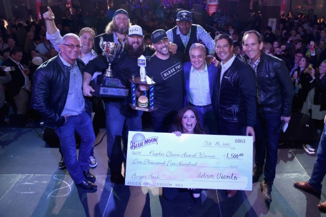 Celebrity chef Robert Irvine, New York Jets Nick Mangold, Ralph Perrazzo of BBD's Beers Burgers Desserts as Pat LaFrieda's 2015 NYCWFF Burger Bash(R) Champion, Blue Moon People's Choice Award winner Chef Joe Isidori of Black Tap, musician Coolio, Rachael Ray, and NYCWFF Founder & Director Lee Brian Schrager celebrate onstage at the Blue Moon Burger Bash presented by Pat LaFrieda Meats hosted by Rachael Ray - Food Network & Cooking Channel New York City Wine & Food Festival presented by FOOD & WINE at Pier 92 on October 16, 2015. (Photo by Larry Busacca/Getty Images for NYCWFF) (PRNewsFoto/NYCWFF)