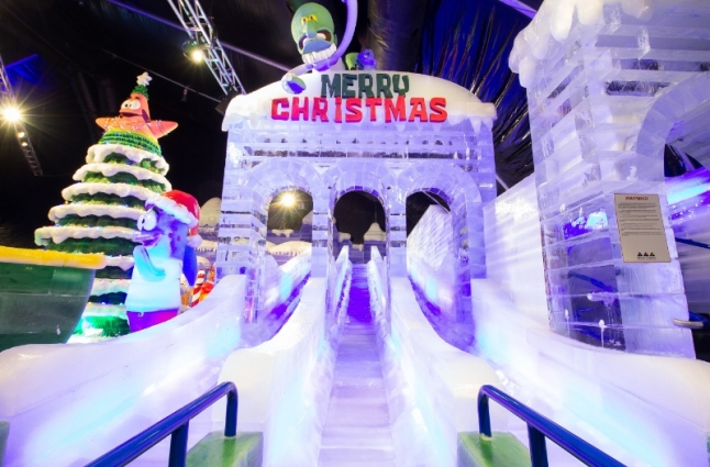 The ice slide is a crowd favorite at Moody Gardens ICE LAND: Ice Sculptures with SpongeBob SquarePants that opened Saturday in Galveston, TX (PRNewsFoto/Moody Gardens)
