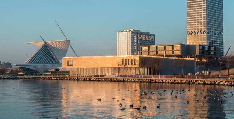 The renovated Milwaukee Art Museum on the shore of Lake Michigan is captured at sunrise. (PRNewsFoto/The Milwaukee Art Museum)