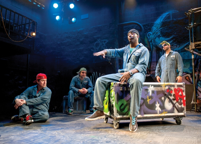 Back from L to R: Jackson Doran (Cassio), GQ (Iago), JQ (Loco Vito) and Postell Pringle (Othello) in Chicago Shakespeare Theater's Othello: The Remix, featured as part of Shakespeare 400 Chicago in 2016. Photo by Michael Brosilow.