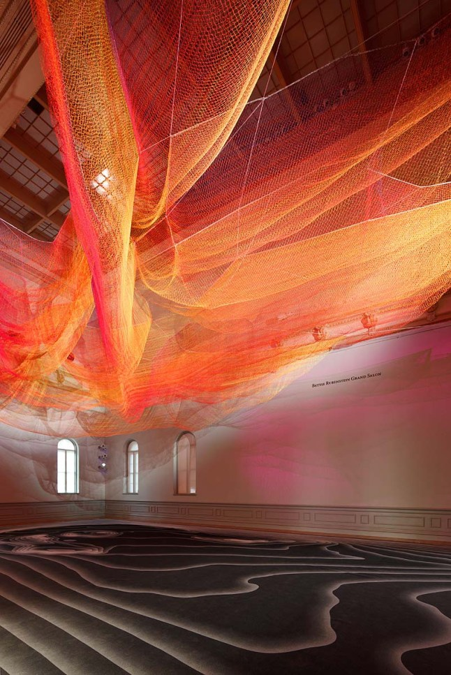 Janet Echelman 1.8 2015 knotted and braided fiber with programmable lighting and wind movement above printed textile flooring 96 x 45 x 40 ft. Courtesy of Janet Echelman, Inc. Renwick Gallery of the Smithsonian American Art Museum. Photos by Ron Blunt
