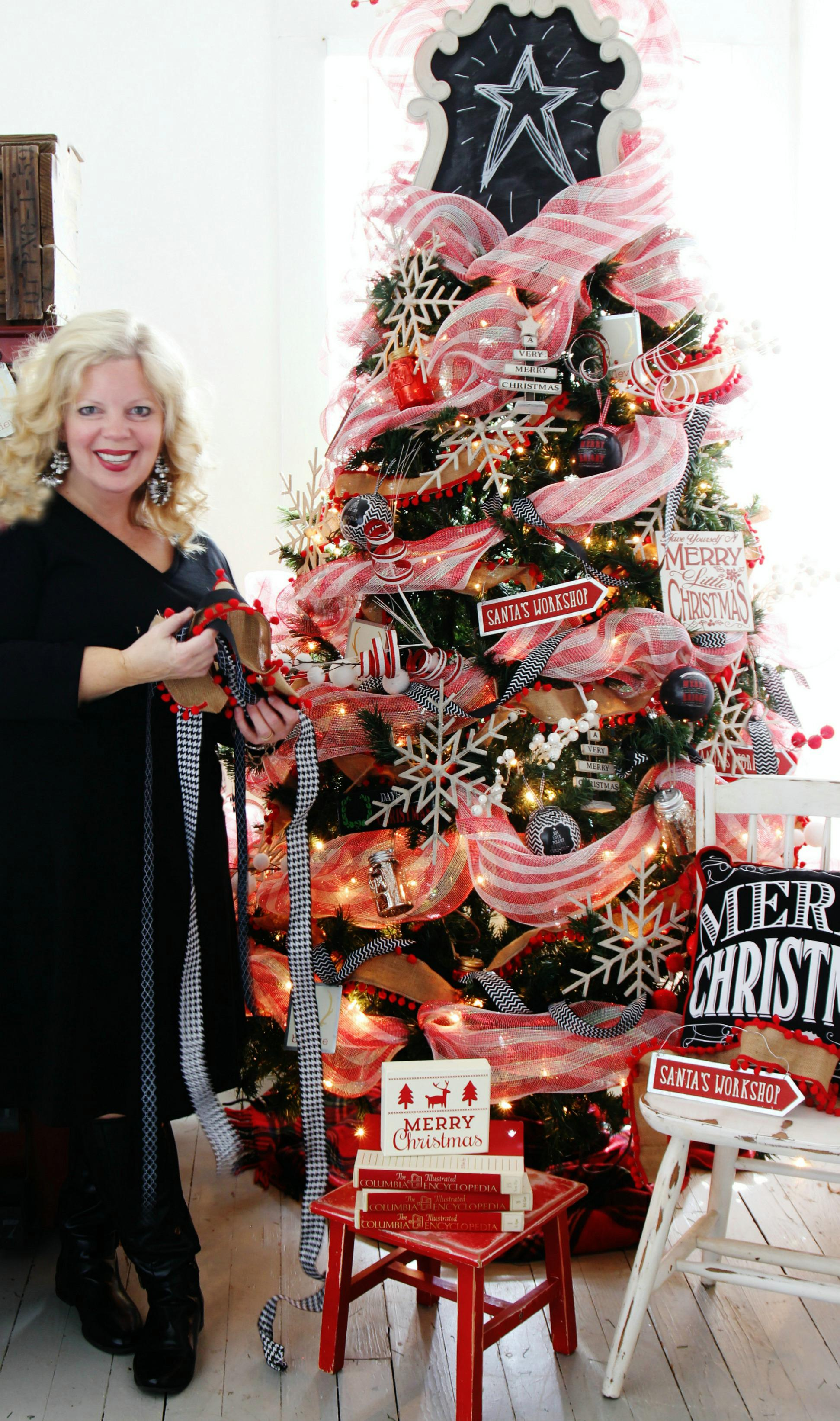 karianne stands next to her christmas tree which is topped with kirklands cream scroll chalkboard_fotor wwwfashionlifestylewordpresscom