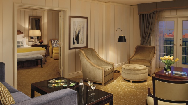 The French doors in the Executive Suite open to a private Juliet balcony with stunning views of the city skyline.