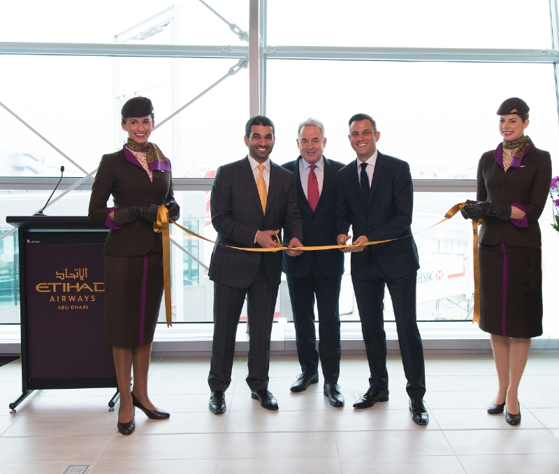Etihad Airways President and Chief Executive Officer James Hogan is joined in a ribbon-cutting ceremony inaugurating the airline's new premium First and Business Class Lounge at New York's John F. Kennedy International Airport by Hareb Almuhairy, Senior Vice President, Corporate and International Affairs (L), Martin Drew, Senior Vice President, The Americas (R) and Etihad Airways' cabin crew. (PRNewsFoto/Etihad Airways)