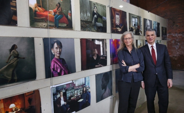 Annie Leibovitz WOMEN: New Portraits exhibition commissioned by UBS. Wapping Hydraulic Power Station. 16 January - 7 February. Pictured: Annie Leibovitz and Sergio P. Ermotti, Group CEO, UBS (C)Peter Macdiarmid (PRNewsFoto/UBS)