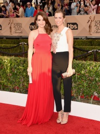 LOS ANGELES, CA - JANUARY 30: Actresses Tina Fey (L) and Kristen Wiig attend The 22nd Annual Screen Actors Guild Awards at The Shrine Auditorium on January 30, 2016 in Los Angeles, California. 25650_015 (Photo by Jason Merritt/Getty Images for Turner)