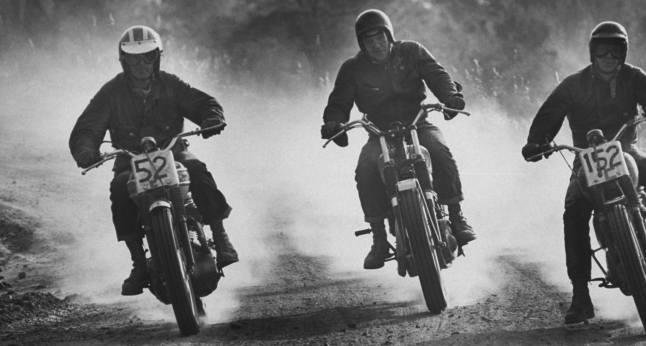 Steve McQueen and Bud Ekins in a motorcycle race