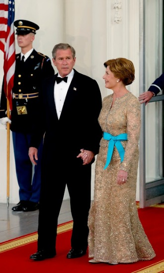 Former President George W. Bush and First Lady Laura Bush (in Oscar de la Renta)
