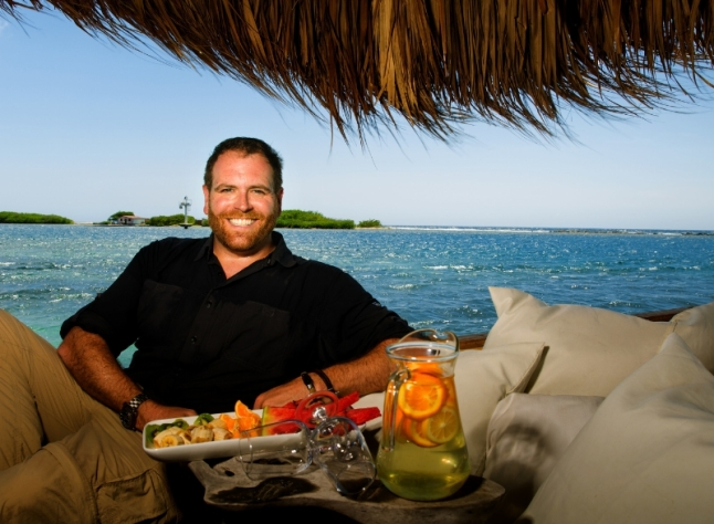 Host Josh Gates enjoys Aruba's local island flavors (PRNewsFoto/Travel Channel)