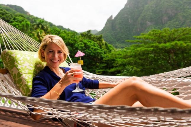 Host Samantha Brown kicks back in a hammock in Saint Lucia (PRNewsFoto/Travel Channel)