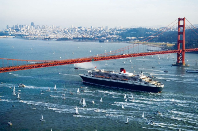 Queen Mary 2, exterior image, sailing under San Francisco Bay, Golden Gate Bridge.