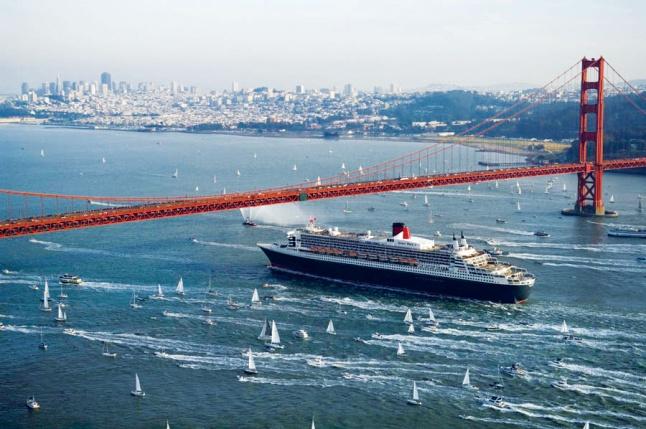 Queen Mary 2, exterior image, sailing under San Francisco Bay, Golden Gate Bridge.