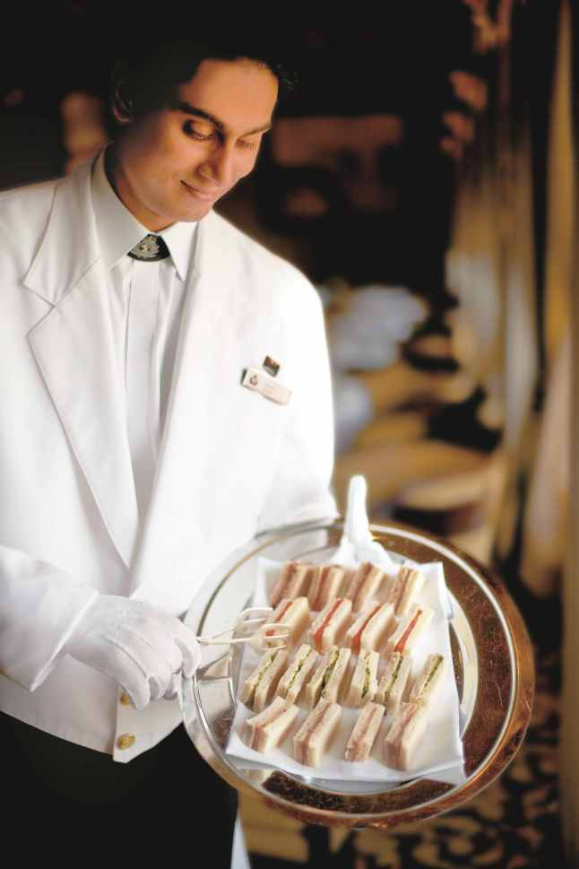 Queen Mary 2, White Star Service, Staff member serving mini sandwiches (2)