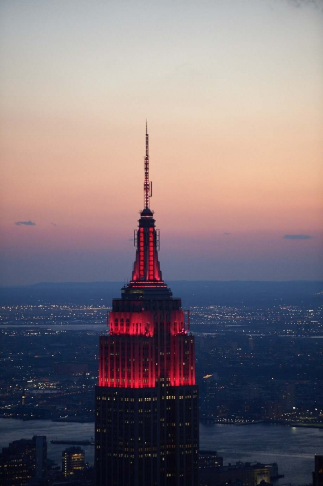 The Empire State Building lit in a red dynamic heart of NYC heartbeat lighting in honor of Valentine's Day.