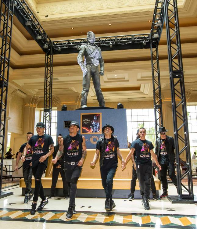 MJ ONE Cast Members Welcome Michael Jackson HIStory Statue