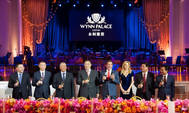 Officiating guests raise a toast at the opening of Wynn Palace.