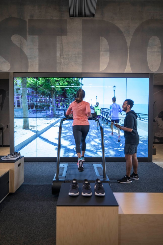 the-nike-running-trial-zone-located-on-the-first-floor-allows-consumers-to-test-shoes-on-a-treadmill-surrounded-by-two-cameras-capturing-data-from-their-run