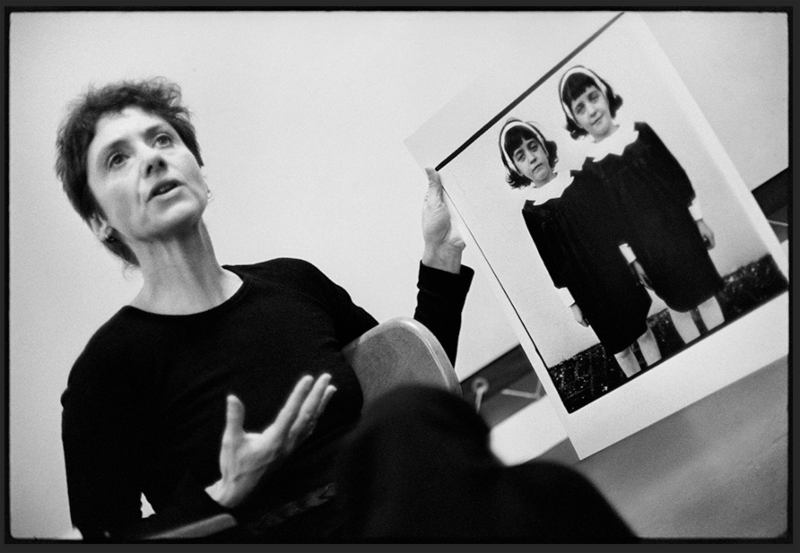 Stephen Frank, Diane Arbus with her photograph Identical twins, Roselle, N.J. 1966, during a lecture at the Rhode Island School of Design in 1970. © Stephen A. Frank
