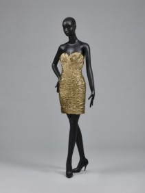 Woman's Dress, designed by Vicky Tiel, American (active Paris), born 1943. Worn by Mrs. Martin Field, 1989. Gold synthetic lamé, shirred. Length: 29 inches, Waist: 25 inches. Philadelphia Museum of Art: Gift of Martin Field, 2014.