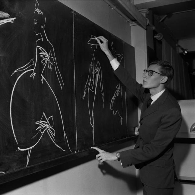 Yves Saint Laurent Drawing on Blackboard Models, November 16, 1957. Photo ©AGIP & Bridgeman Images.